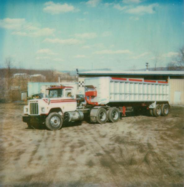 white and red tractor trailer