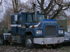 Mack R 600 with pipe through hood