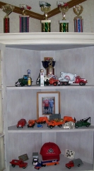 model and trophy cabinet