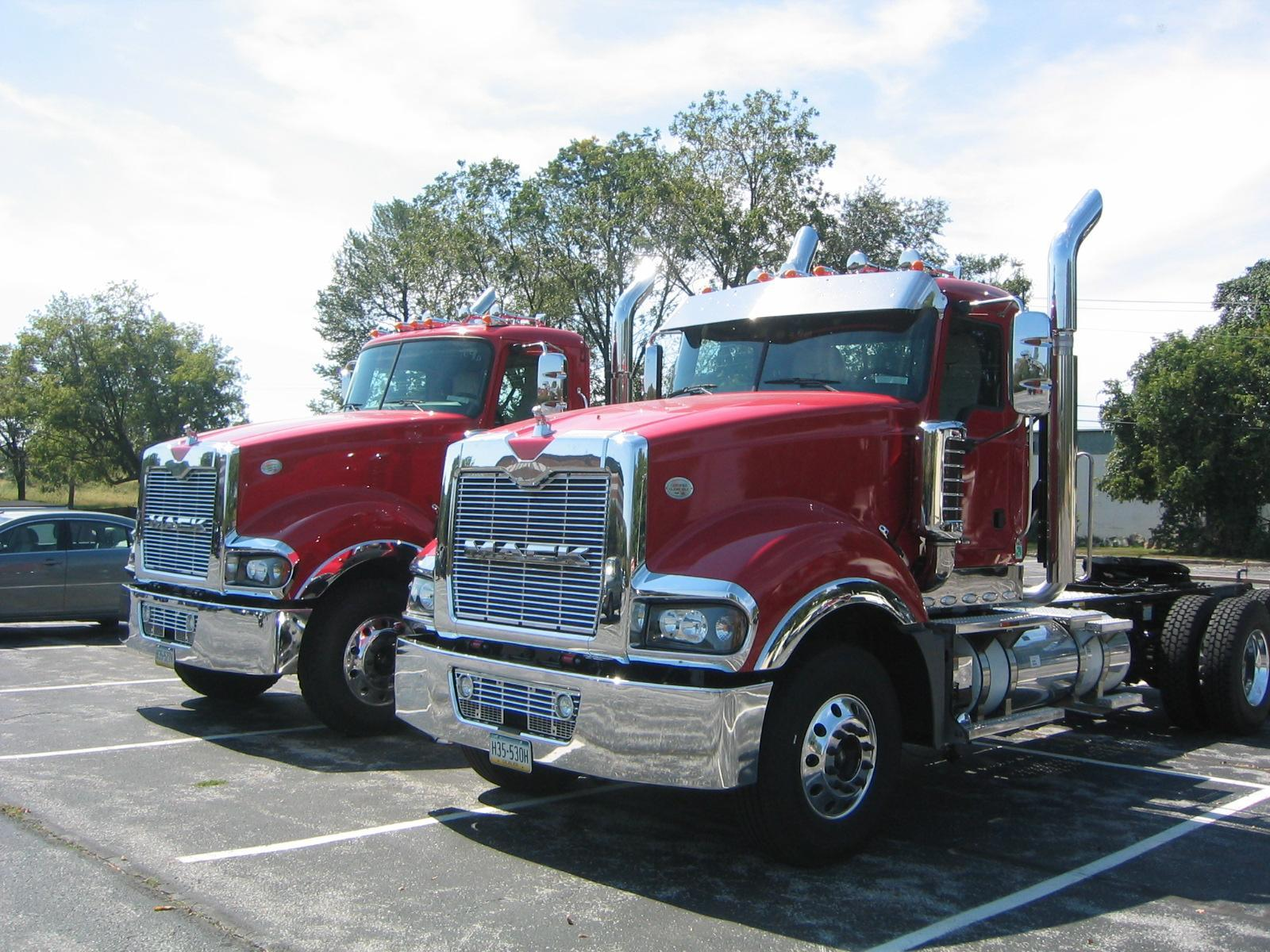 two red Titan tractors