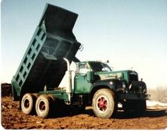 Mack 10 Wheeler drivers dump bigger loads........