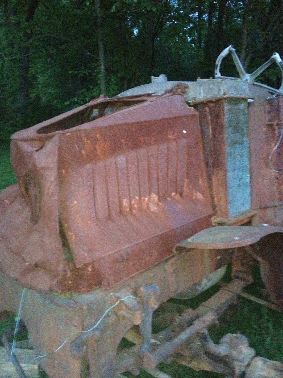 Seller found the hood in a trailer.  Dented good, but bought it anyway.
