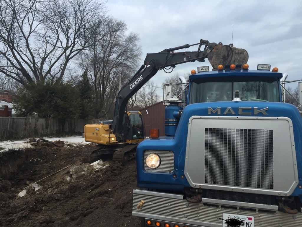 Loading out broken concrete on demo job