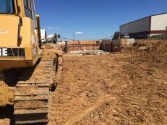 Forming manure pit walls