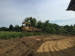 955L moving black dirt on site in Lake Carroll
